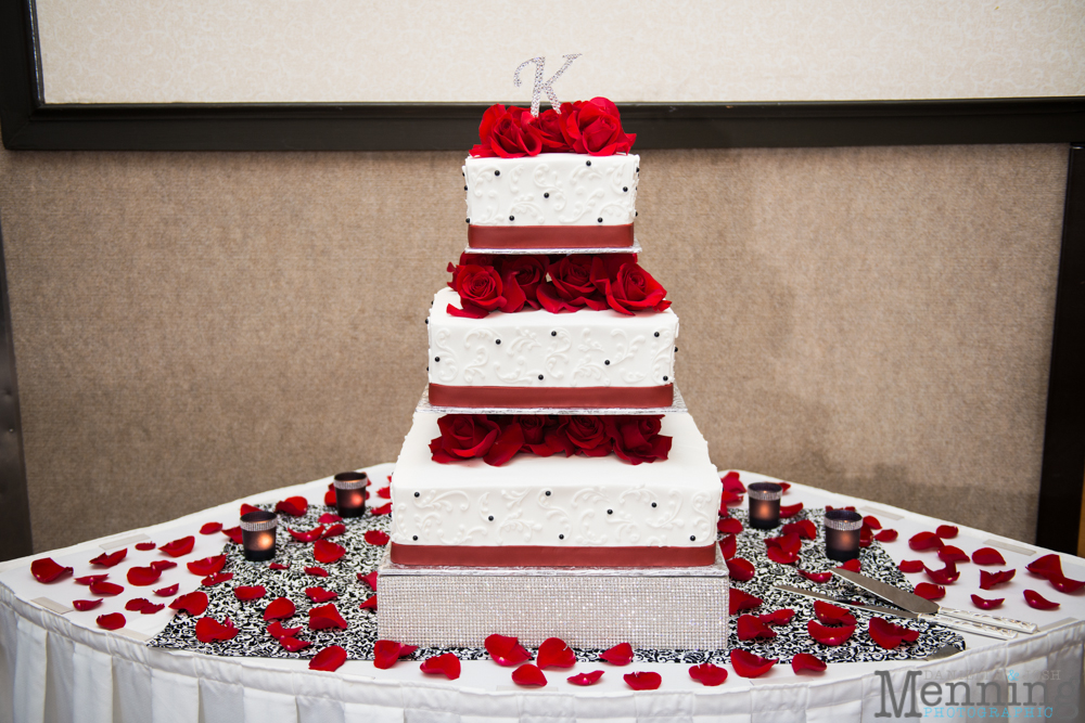 red and white wedding cake with roses